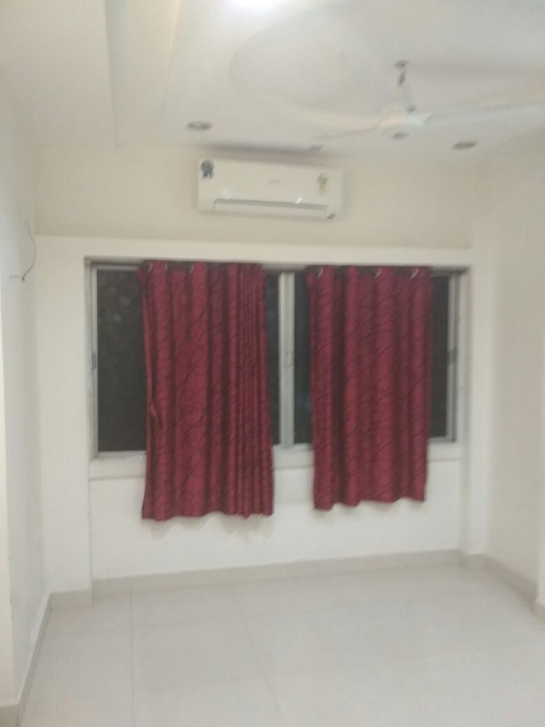 with modular kitchen, wardrobes ,2bhk semifurnished posh flat available for rent 15000